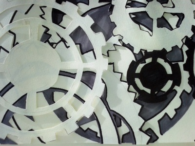 Layered paper cut out cogs.